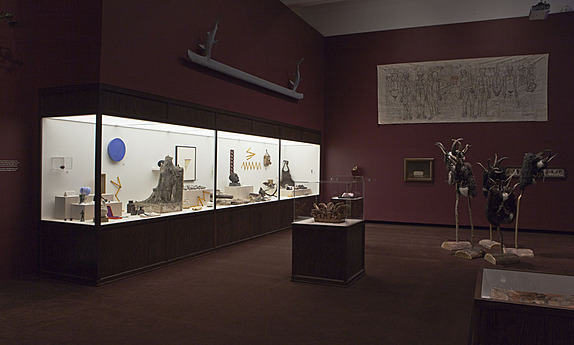 A Wunderkammer, or Cabinet of Curiosities, in the exhibition Midnight Party contains more than 100 artworks—from a wooden box of herring bones to fearsome masks with fur and horns