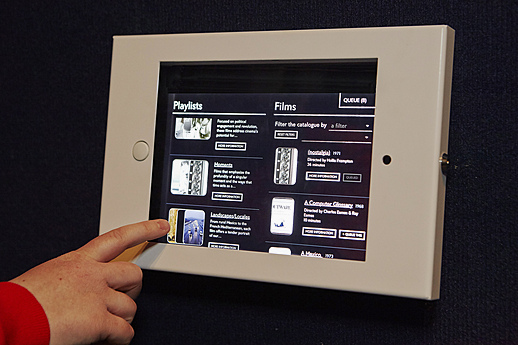 Selecting a film using the Mediatheque's touchscreen remote